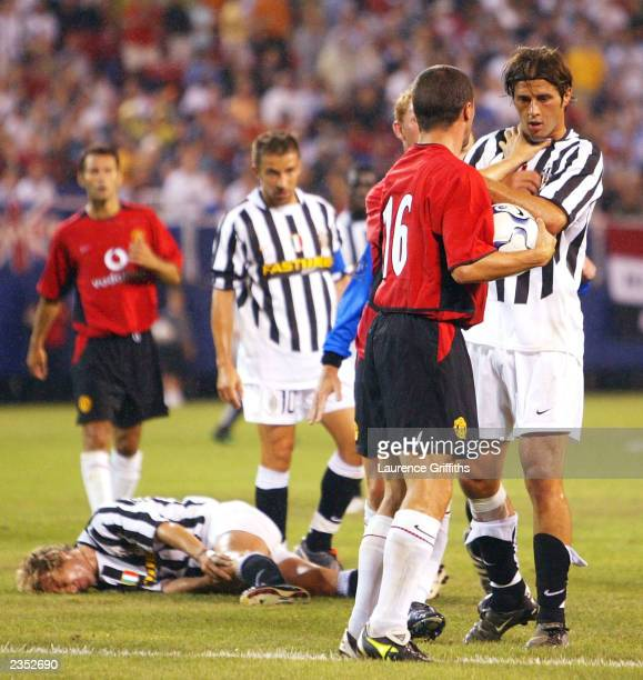 Roy Keane of Manchester United makes his feelings clear to Alessio Tacchinardi of Juventus after a typically hard challenge during a Champions World...