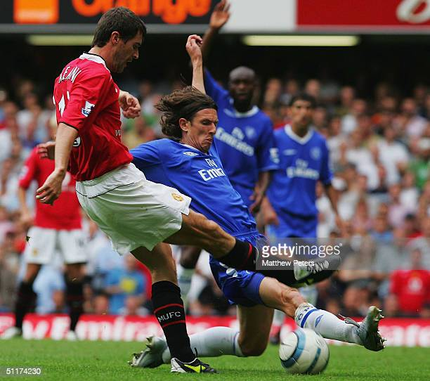 Roy Keane of Manchester United tussles with Alexei Smertin of Chelsea during the Barclays Premiership match between Chelsea and Manchester United at...