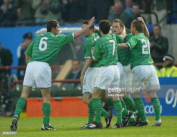 Roy Keane playing for Ireland for the first time in two years, congratulates Matt Holland on scoring the winning goal during the International...