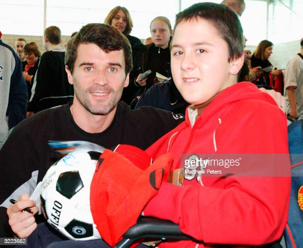 Roy Keane poses with Jonathan Debono from Malta during a Meet and Greet with disabled and terminally ill children at Carrington Training Ground where...