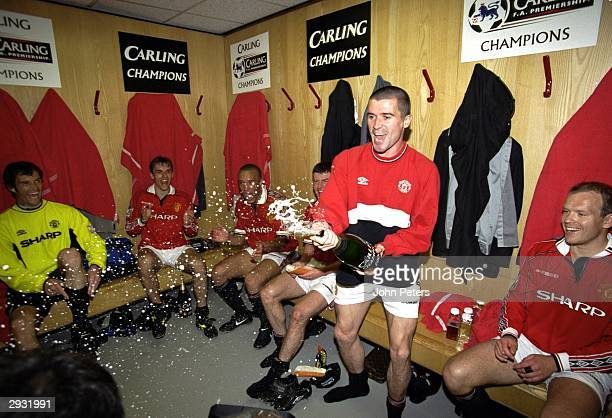 Roy Keane Raimond van der Gouw Phil Neville Mikael Silvestre Denis Irwin and Henning Berg celebrate in the dressing room after the FA Premiership...