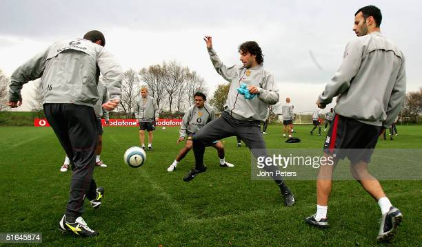 Roy Keane Ruud van Nistelrooy and Ryan Giggs of Manchester United in action during a first team training session ahead of the UEFA Champions League...