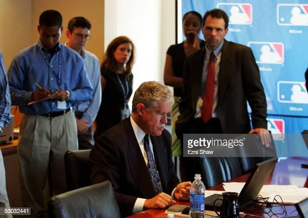 Roy Krasik Senior Director of Major League Baseball Operations sits at his computer during the Major League Baseball draft on June 7 2005 at the...