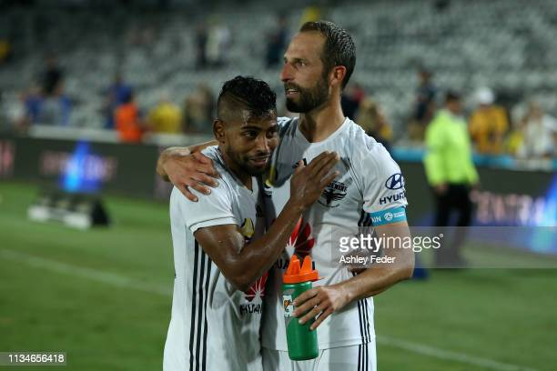 Roy Krishna and Andrew Durante of Wellington Phoenix celebrate after the win during the round 21 ALeague match between the Central Coast Mariners and...