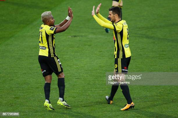 Roy Krishna and Dario Vidosic of the Phoenix celebrate the goal of Andrija Kaludjerovic during the round four ALeague match between the Wellington...