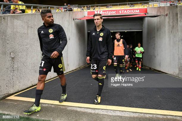 Roy Krishna and Matthew Ridenton of the Phoenix take the field to warm up during the round one ALeague match between Wellington Phoenix and Adelaide...