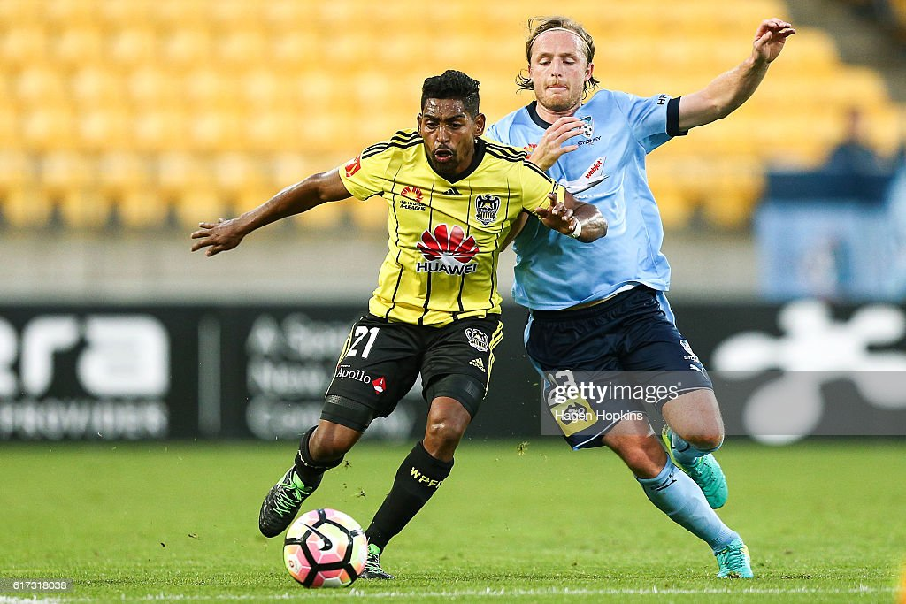Roy Krishna of the Phoenix and Rhyan Grant of Sydney FC compete for a loose ball during the round three A-League match between the Wellington Phoenix and Sydney FC at Westpac Stadium on October 23, 2016 in Wellington, New Zealand.