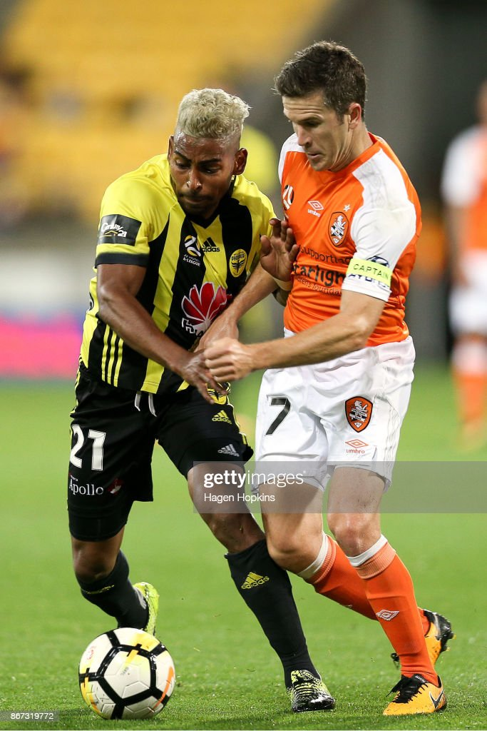 Roy Krishna of the Phoenix and Thomas Kristensen of Brisbane compete for the ball during the round four A-League match between the Wellington Phoenix and the Brisbane Roar at Westpac Stadium on October 28, 2017 in Wellington, New Zealand.