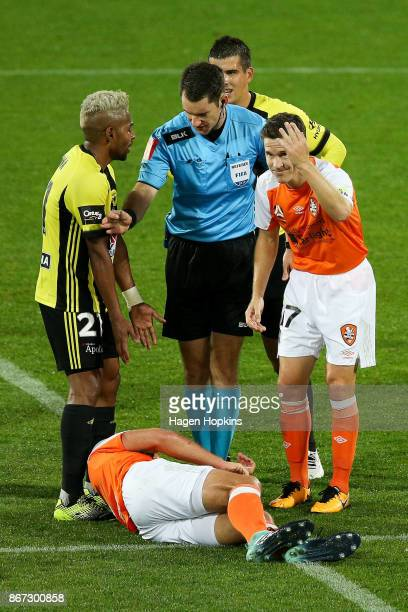 Roy Krishna of the Phoenix appeals to referee Jarred Gillett after a challenge on Luke DeVere of Brisbane during the round four ALeague match between...