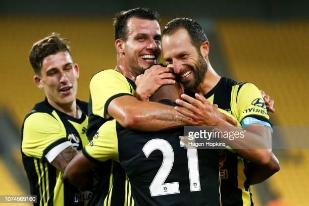 Roy Krishna of the Phoenix celebrates with Steven Taylor Andrew Durante and Louis Fenton after scoring a goal during the round nine ALeague match...