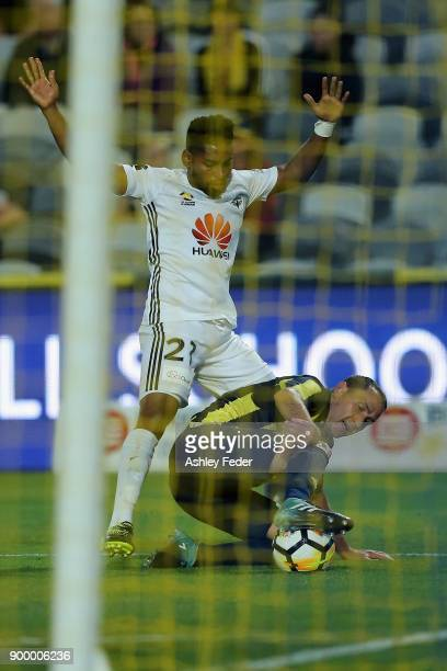 Roy Krishna of the Phoenix contests the ball against Alan Baro of the Mariners during the round 13 ALeague match between the Central Coast Mariners...