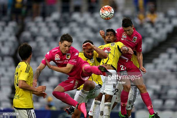 Roy Krishna of the Phoenix contests the header against Jake McGing of the Mariners during the round five A-League match between the Central Coast...