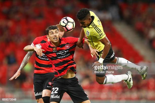Roy Krishna of the Phoenix flies through the air to compete for a header with Jonathan Aspropotamitis and Jack Clisby of the Wanderers during the...