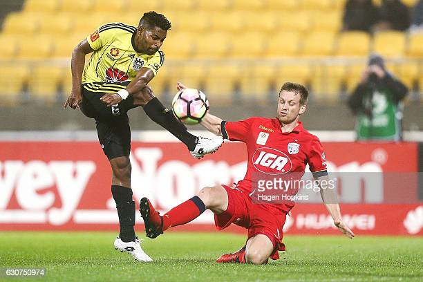 Roy Krishna of the Phoenix has his shot blocked by Ryan Kitto of Adelaide United during the round 13 ALeague match between Wellington Phoenix and...