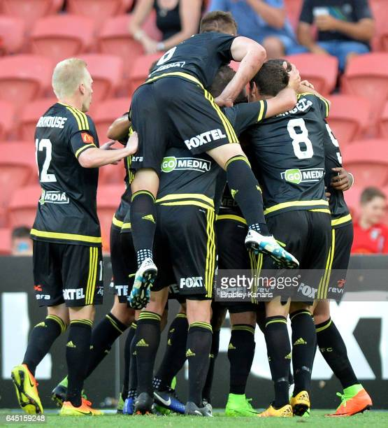 Roy Krishna of the Phoenix is congratulated by team mates after scoring a goal during the round 21 ALeague match between the Brisbane Roar and the...