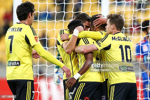 Roy Krishna of the Phoenix is congratulated on his goal by teammates during the round five ALeague match between the Wellington Phoenix and the...