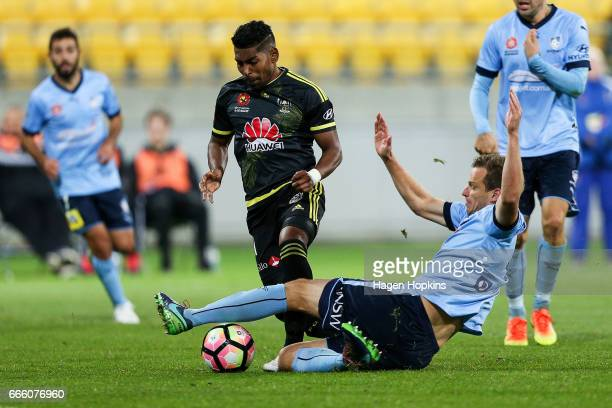 Roy Krishna of the Phoenix is tackled by Alex Wilkinson of Sydney FC during the round 26 ALeague match between the Wellington Phoenix and Sydney FC...