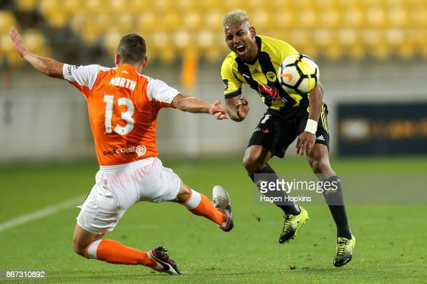 Roy Krishna of the Phoenix is tackled by Jade North of Brisbane during the round four ALeague match between the Wellington Phoenix and the Brisbane...