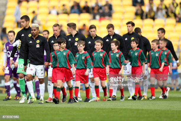 Roy Krishna of the Phoenix leads his team onto the field during the round six ALeague match between the Wellington Phoenix and the Perth Glory at...