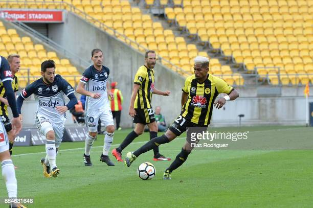 Roy Krishna of the Wellington Phoenix tries to keep the ball away from Christian Theoharous of Melbourne Victory during the round nine ALeague match...