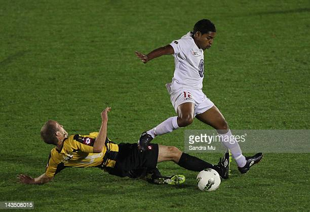 Roy Krishna of Waitakere leaps over Michael Eagar of Wellington during the 2012 ASB Premiership Grand Final match between Waitakere United and Team...
