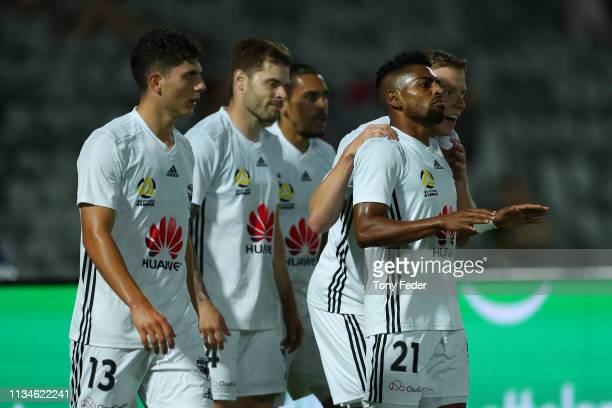 Roy Krishna of Wellington Phoenix celebrates a goal with team mates during the round 21 ALeague match between the Central Coast Mariners and the...
