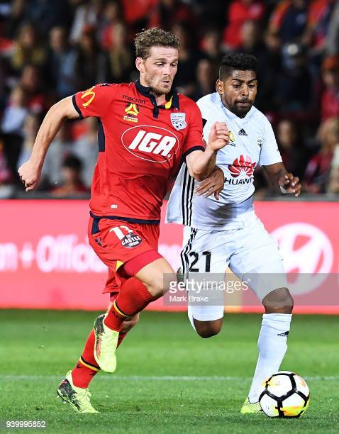 Roy Krishna of Wellington Phoenix deliberatley fouls Johan Absalonsen of Adelaide United and is yellow carded during the round 25 A-League match...