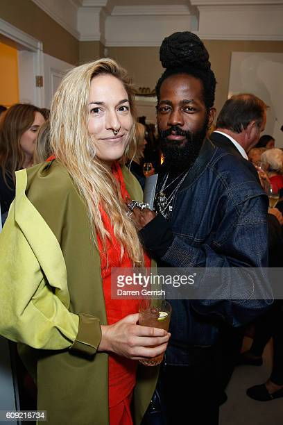 Roy Luwolt and Mary Alice Malone attend Vogue Voice of a Century book launch at Matches Fashion on September 20, 2016 in London, England.
