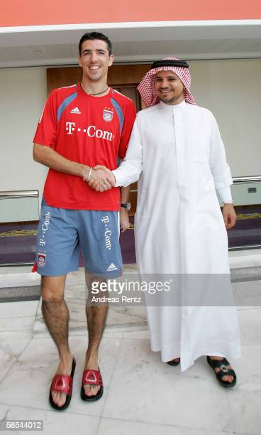 Roy Maakay shakes hands with Sheikh Hamad bin Mejren Dubai's Tourist Chief prior of a press conference during a Bayern Munich training session at the...