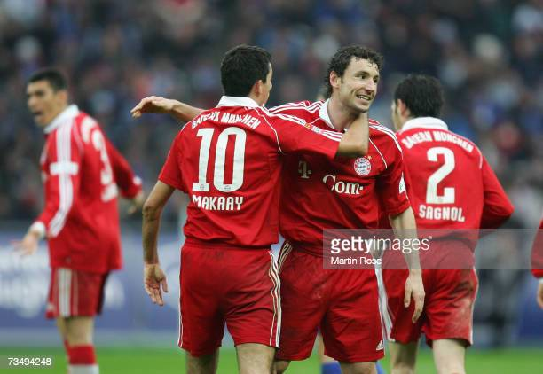 Roy Makaay and Mark van Bommel of Munich celebrate the 3rd goal during the Bundesliga match between Hertha BSC Berlin and Bayern Munich at the...