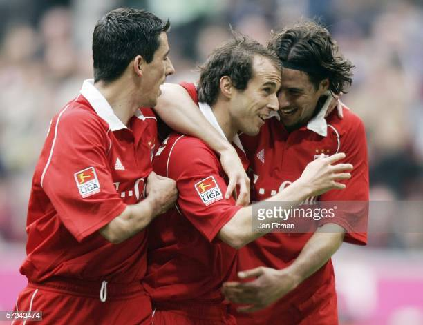 Roy Makaay Mehmet Scholl and Claufio Pizarro of Bayern Munich jubilate after Scholl scored 20 during the Bundesliga match between Bayern Munich and...