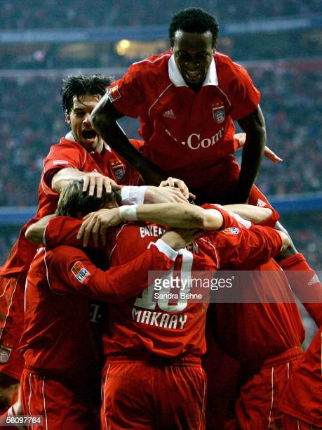Roy Makaay of Bayern celebrates with teammates Michael Ballack Ze Roberto and Sebastian Deisler after scoring the fourth goal during the Bundesliga...