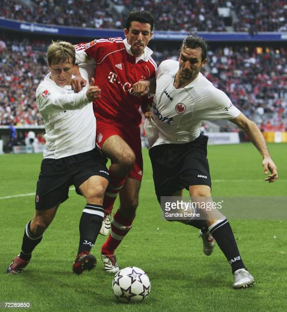Roy Makaay of Bayern Munich is challenged by Christoph Spycher and Sotirios Kyrgiakos of Eintracht Frankfurt during the Bundesliga match between FC...
