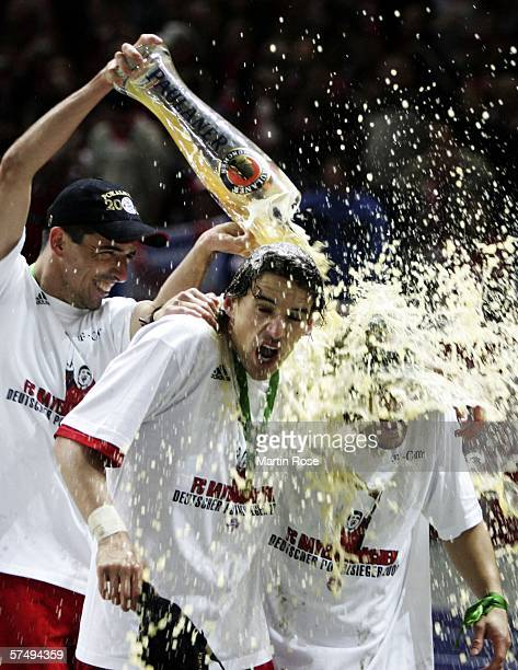 Roy Makaay of Bayern Munich showers his team mates Owen Hargreaves an Bixente Lizarazou with beer after winning the DFB German Cup final between...