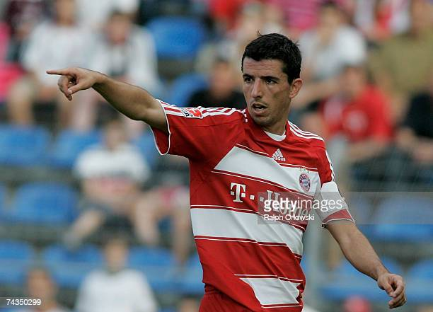 Roy Makaay of FC Bayern Munich points during their friendly match against SV Waldhof Mannheim at the Carl-Benz-Stadium May 24, 2007 in Mannheim,...