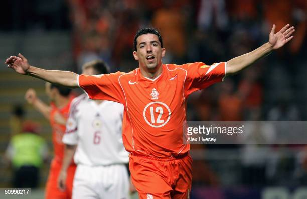 Roy Makaay of Holland celebrates after scoring the third goal during the UEFA Euro 2004 Group D match between Holland and Latvia at the Braga...