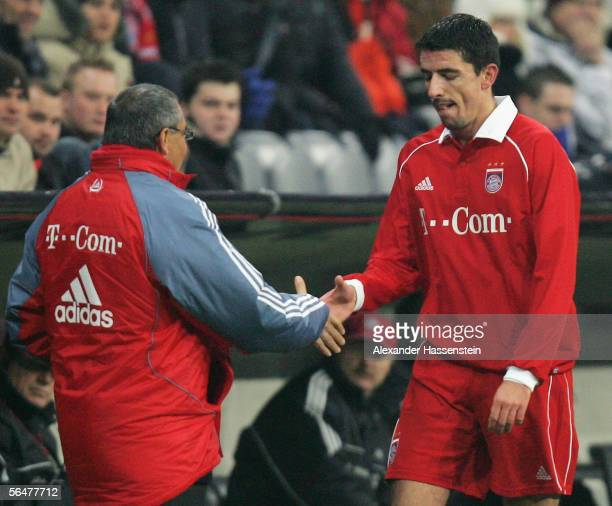 Roy Makaay of Munich shakes the hand of his coach Felix Magath after leaving the field during the last sixteen match of the DFB German Cup between...