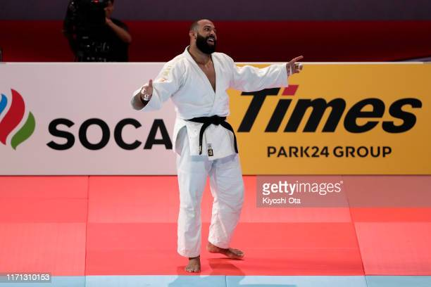 Roy Meyer of the Netherland celebrates his victory over Guram Tushishvili of Georgia in the Men's +100kg bronze medal bout on day seven of the World...