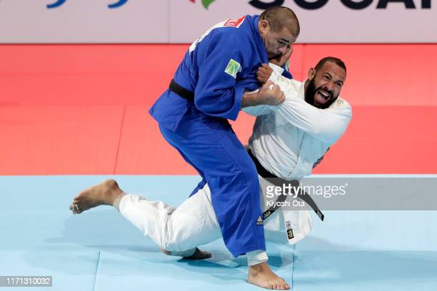 Roy Meyer of the Netherland throws Guram Tushishvili of Georgia in the Men's +100kg bronze medal bout on day seven of the World Judo Championships at...