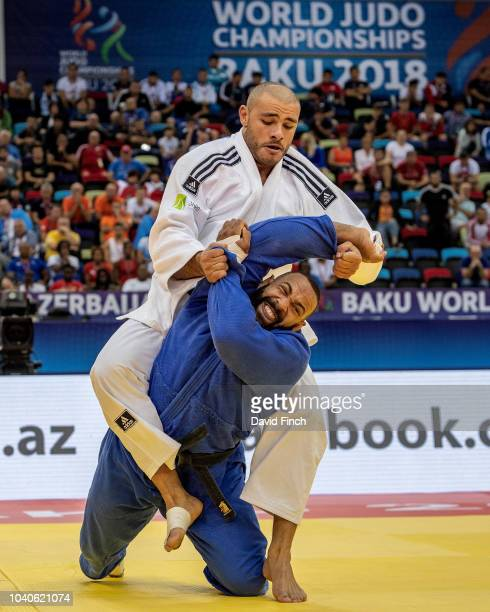 Roy Meyer of the Netherlands attacks Guram Tushishvili of Georgia but eventually lost the 100kg quarterfinal contest by an ippon during day seven of...