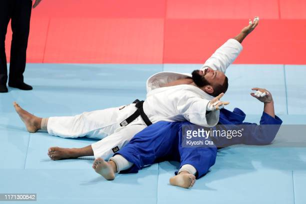 Roy Meyer of the Netherlands celebrates his victory over David Moura of Brazil in the Men's +100kg Repechage on day seven of the World Judo...