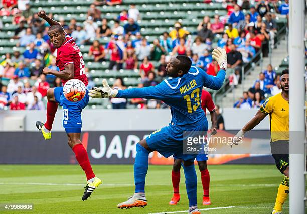 Roy Miller of Costa Rica scores a goal as Dwayne Miller of Jamaica attempt to stop the ball during the 2015 CONCACAF Gold Cup Group B match between...