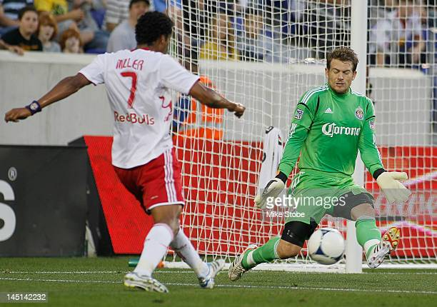 Roy Miller of the New York Red Bulls fires the ball past Dan Kennedy of the Chivas USA at Red Bull Arena on May 23 2012 in Harrison New Jersey Red...