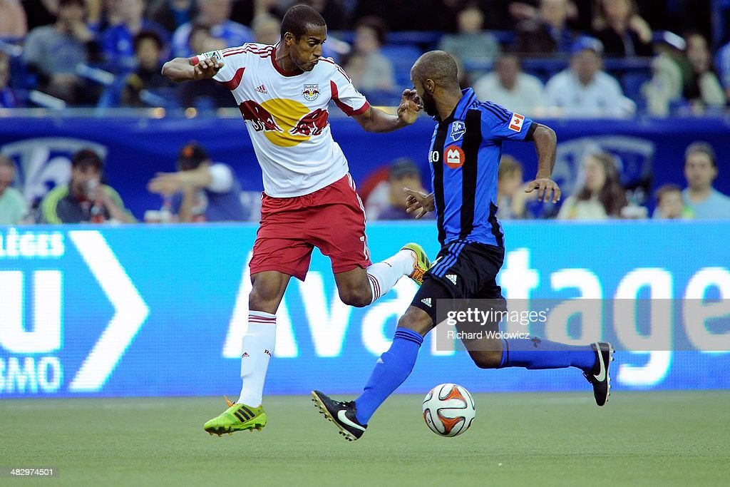 Roy Miller #7 of the New York RedBulls and Collen Warner #18 of the Montreal Impact chase the ball during the MLS game at the Olympic Stadium on April 5, 2014 in Montreal, Quebec, Canada.
