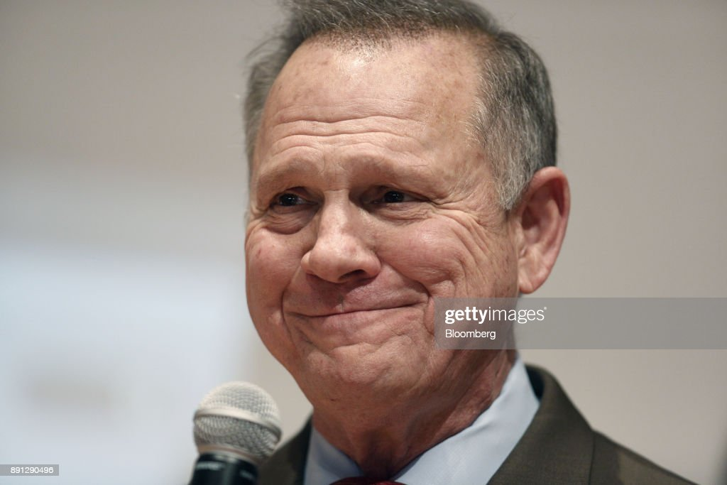 Roy Moore, a Republican from Alabama, pauses while speaking during an election night party in Montgomery, Alabama, U.S., on Tuesday, Dec. 12, 2017. The defeat of Moore in Alabamas U.S. Senate race by Democrat Doug Jones was a stunning rebuke to the GOPs anti-establishment wing led by Steve Bannon and a major political embarrassment for President Donald Trump. Photographer: Luke Sharrett/Bloomberg via Getty Images