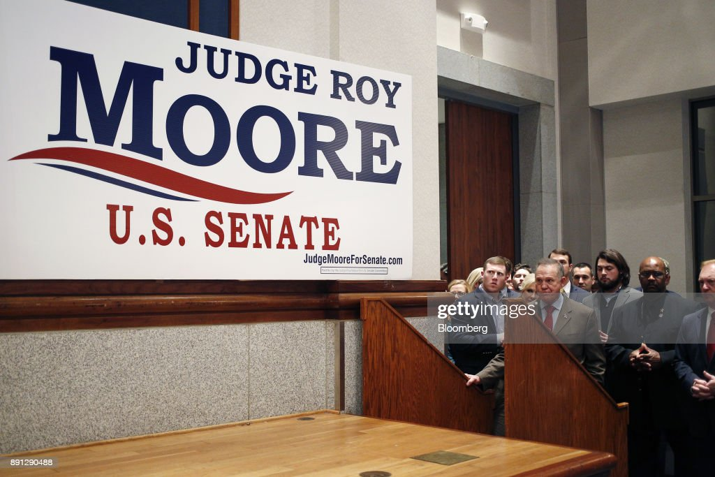 Roy Moore, a Republican from Alabama, stands off stage during an election night party in Montgomery, Alabama, U.S., on Tuesday, Dec. 12, 2017. The defeat of Moore in Alabamas U.S. Senate race by Democrat Doug Jones was a stunning rebuke to the GOPs anti-establishment wing led by Steve Bannon and a major political embarrassment for President Donald Trump. Photographer: Luke Sharrett/Bloomberg via Getty Images