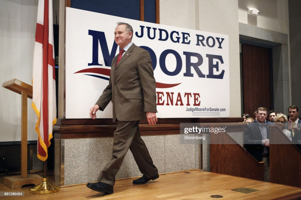 Roy Moore, a Republican from Alabama, walks onstage during an election night party in Montgomery, Alabama, U.S., on Tuesday, Dec. 12, 2017. The defeat of Moore in Alabamas U.S. Senate race by Democrat Doug Jones was a stunning rebuke to the GOPs anti-establishment wing led by Steve Bannon and a major political embarrassment for President Donald Trump. Photographer: Luke Sharrett/Bloomberg via Getty Images