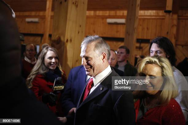 Roy Moore Republican candidate for US Senate from Alabama center and his wife Kayla Moore right leave a campaign rally in Midland City Alabama US on...