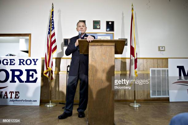 Roy Moore Republican candidate for US Senate from Alabama pauses while speaking during a campaign rally in Henagar Alabama US on Monday Nov 27 2017...