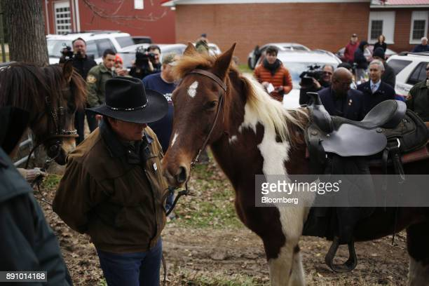 Roy Moore Republican candidate for US Senate from Alabama walks with a horse after casting his ballot inside a polling location in Gallant Alabama US...